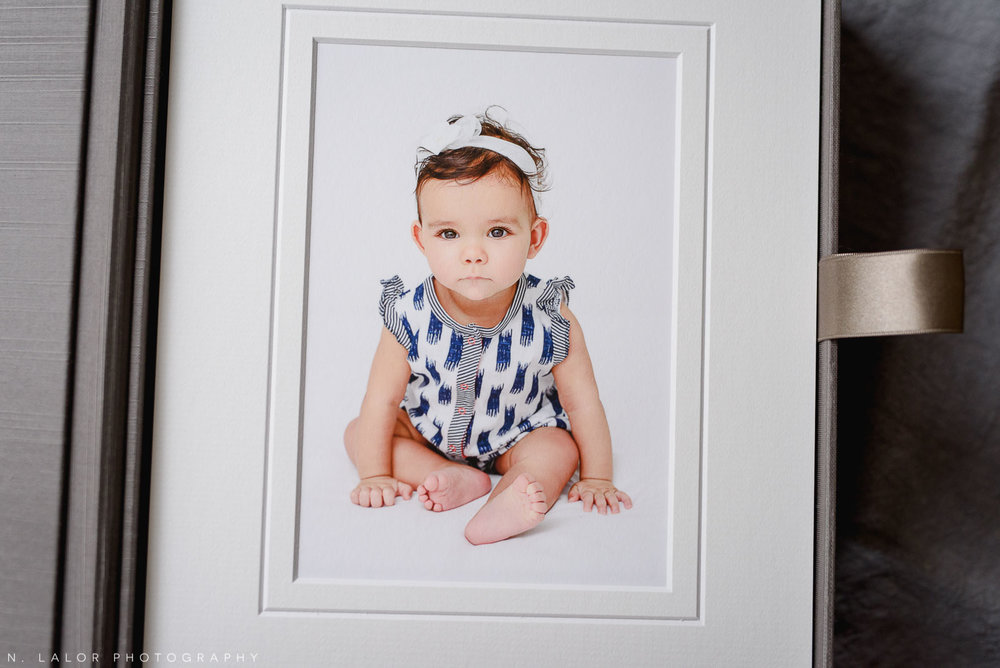 Matted fine art print of 8-month old baby. Baby milestone session with N. Lalor Photography in Greenwich, Connecticut.
