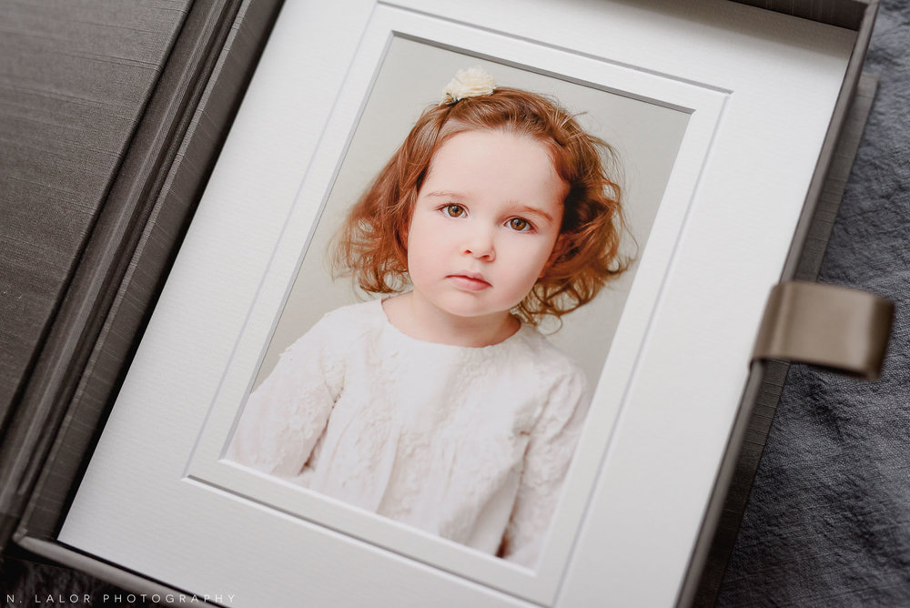 Portrait of 2-year old girl. Family photo session with N. Lalor Photography in Greenwich, Connecticut.