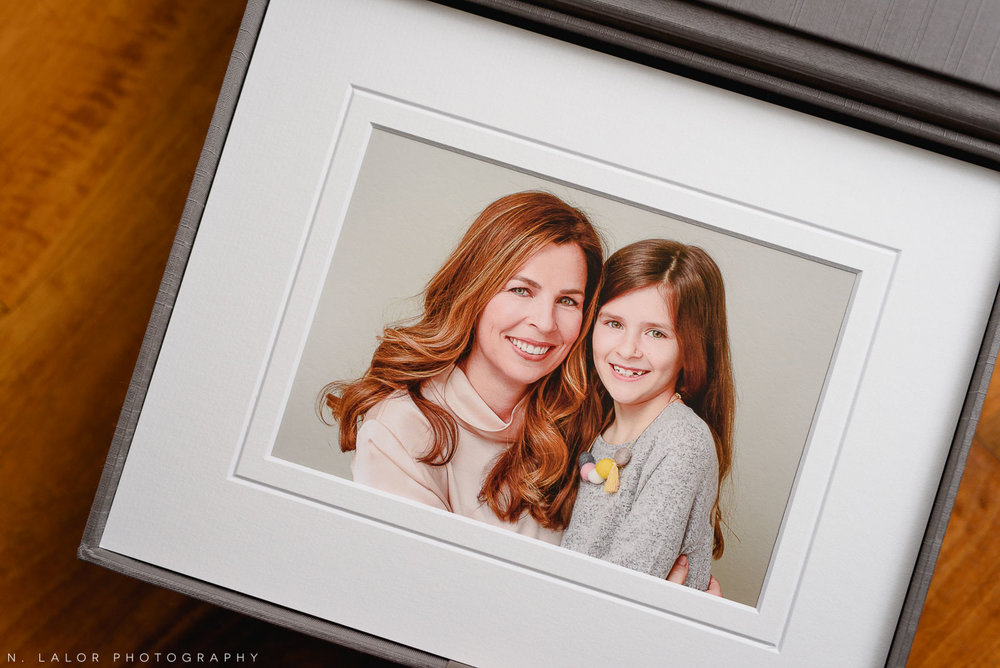 Mother and 7-year old daughter. Fine art print. Family photo session with N. Lalor Photography in Greenwich, Connecticut.