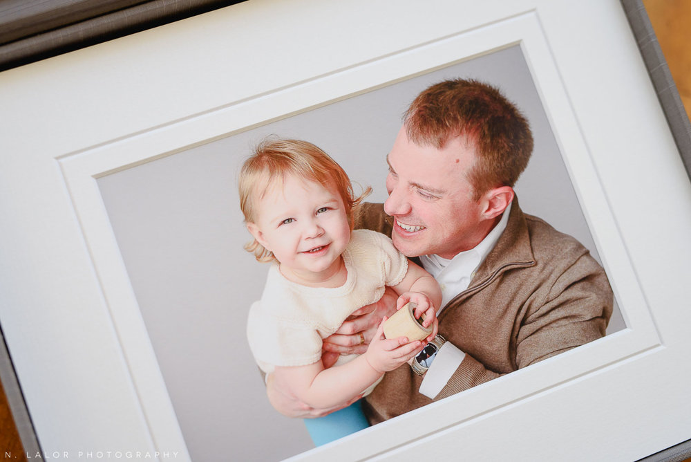 Candid Studio shot of Dad and his little girl. Family portrait session with N. Lalor Photography in Greenwich Connecticut.