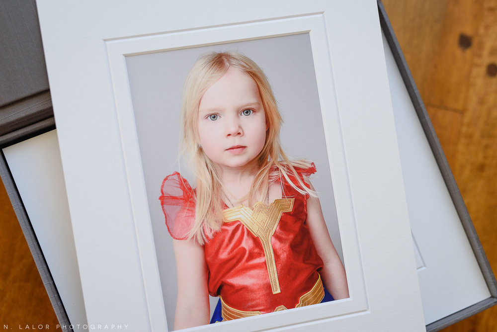 Portrait of a little girl dresses as Wonder Woman. Family portrait session with N. Lalor Photography in Greenwich Connecticut.