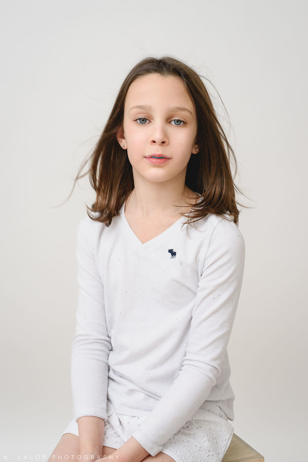 Simple and clean photograph of a tween girl. Studio portrait by N. Lalor Photography in Greenwich, Connecticut.