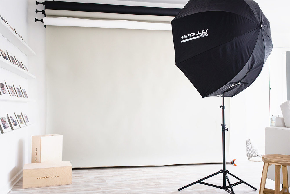 Image of a light stand and photography backgrounds at N. Lalor Photography's Studio in Greenwich, Connecticut.