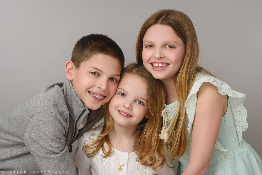 Image of 3 siblings in coordinating outfits. Studio portrait by N. Lalor Photography in Greenwich, Connecticut.
