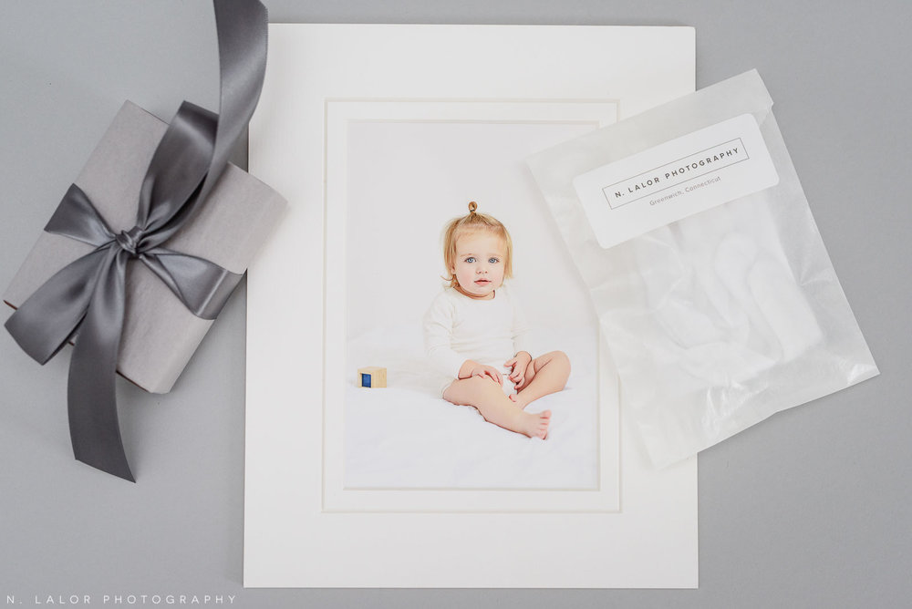 Image of a matted print, photo stand, and white gloves. Photograph by N. Lalor Photography in Greenwich, Connecticut.