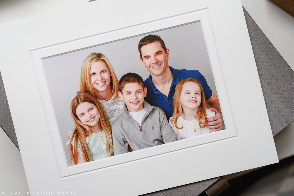 Image of a archival print, showing photograph of a family wearing coordinated outfits as part of their Studio photo session with N. Lalor Photography.