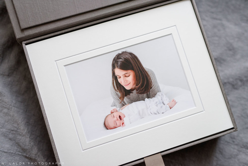 Mom and her newborn baby.Studio portrait by N. Lalor Photography in Greenwich, Connecticut.