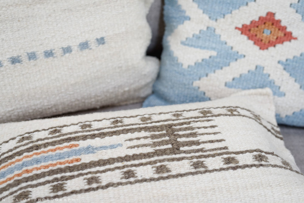 Detail of decorative pillows, showing texture. Local Small Business photoshoot for METTA10 by N. Lalor Photography. Westport, Connecticut.