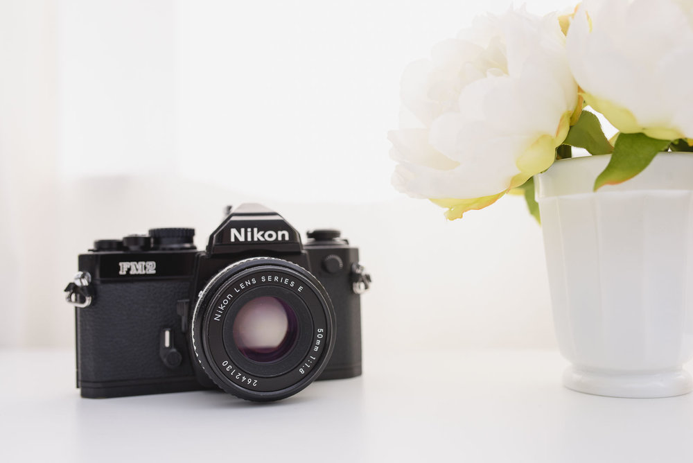 Image of a 1980s Nikon FM2 camera with a 50mm Series E lens.