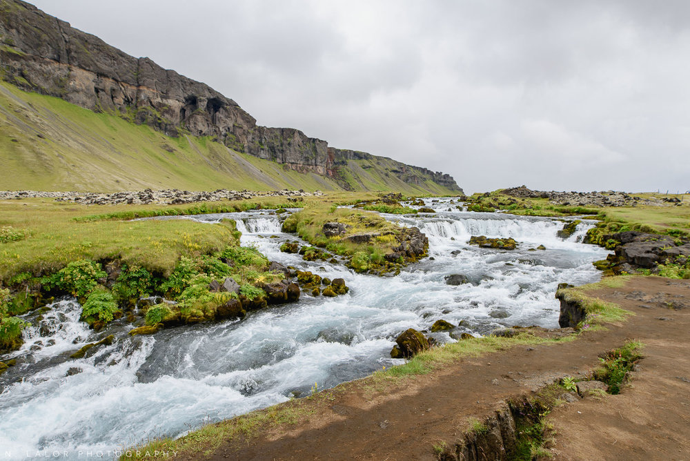 Rivers and waterfalls by the side of the road. From my trip to Iceland in 2018. Photograph by Nataliya Lalor.