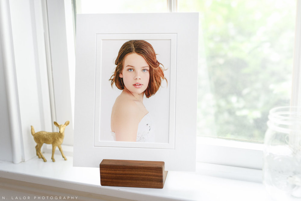 Image of a fine art print, displayed using a wooden photo stand. Portrait by N. Lalor Photography in Greenwich, Connecticut.