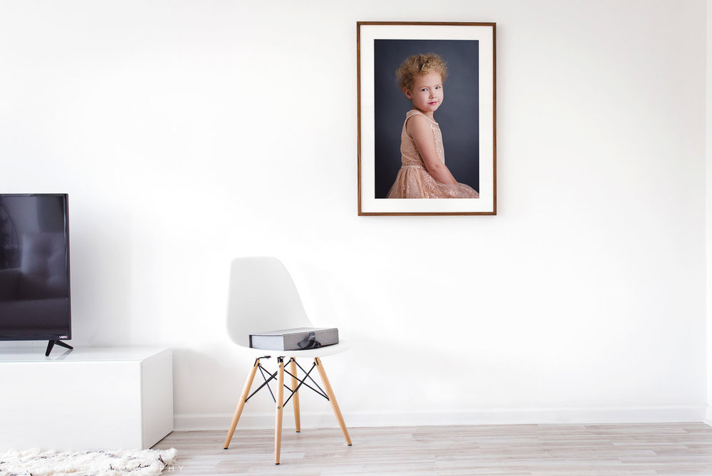 Image of a large frame on the wall. Portrait by N. Lalor Photography in Greenwich, Connecticut.
