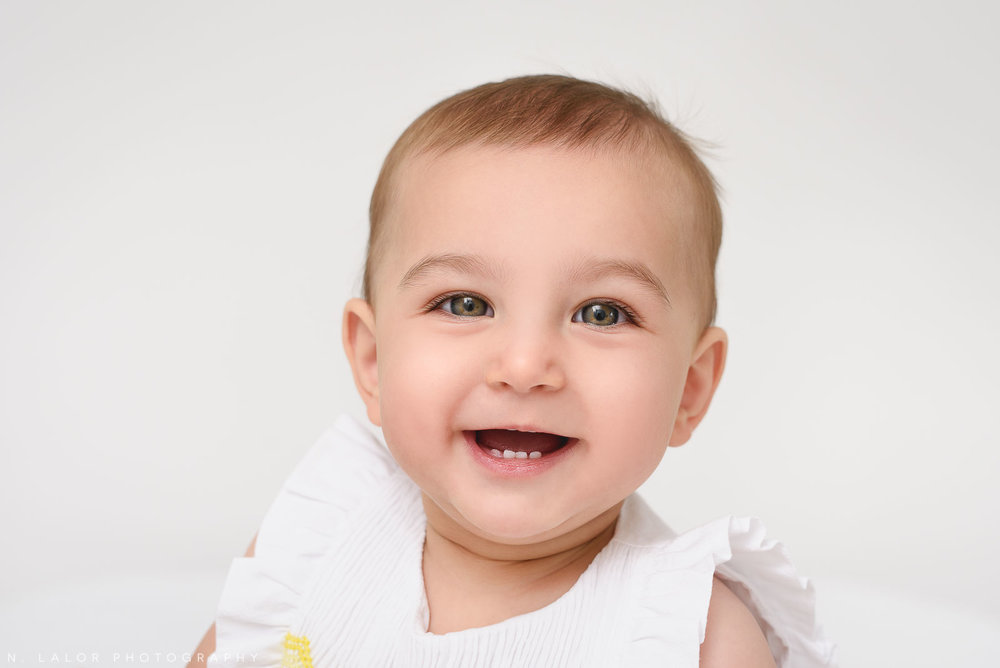 Happy smiling baby girl. Portrait by N. Lalor Photography in Greenwich Connecticut.