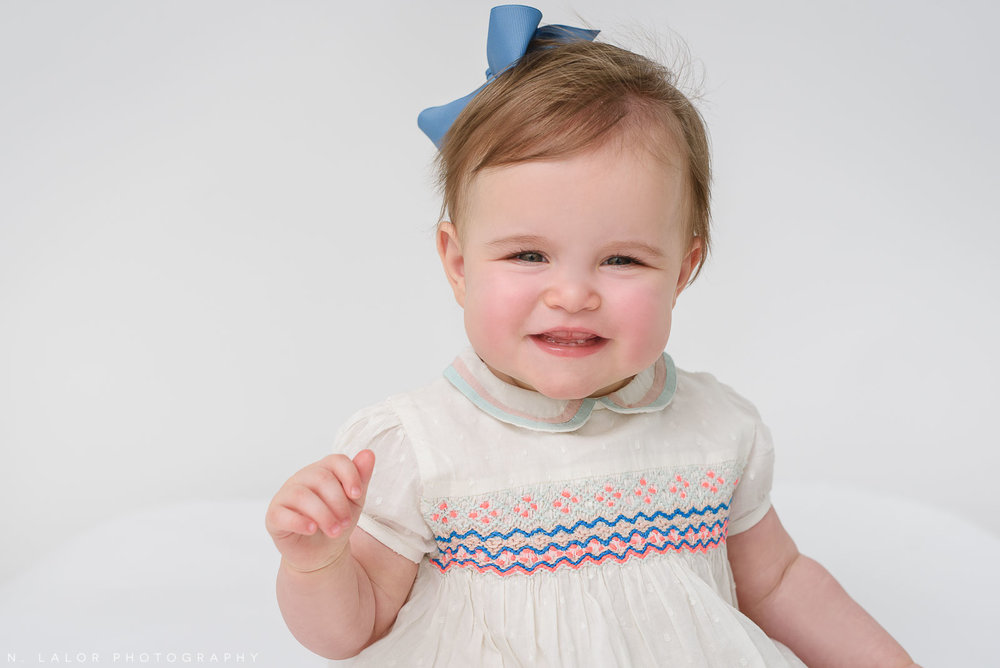 Smiling baby girl. Portrait by N. Lalor Photography in Greenwich Connecticut.