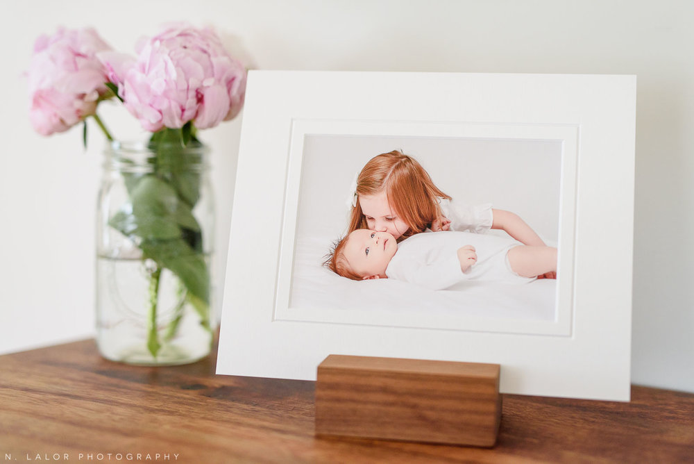 Image of a matted FineArt print on a table. Studio portrait by N. Lalor Photography in Greenwich, CT.