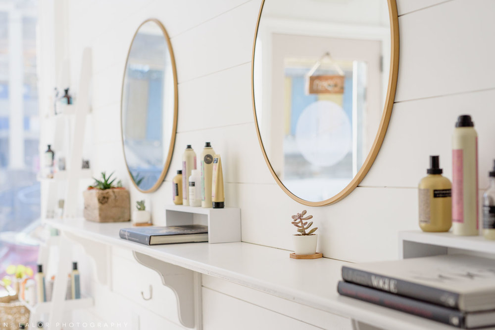 Haus of Pretty interior, round mirrors and art books. Photo by N. Lalor Photography.