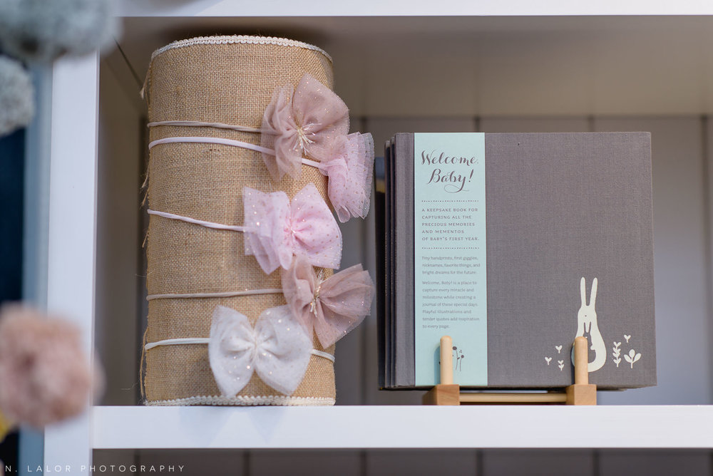 Back 40 Mercantile baby headbands and baby book, in Old Greenwich, Connecticut. Image by N. Lalor Photography.