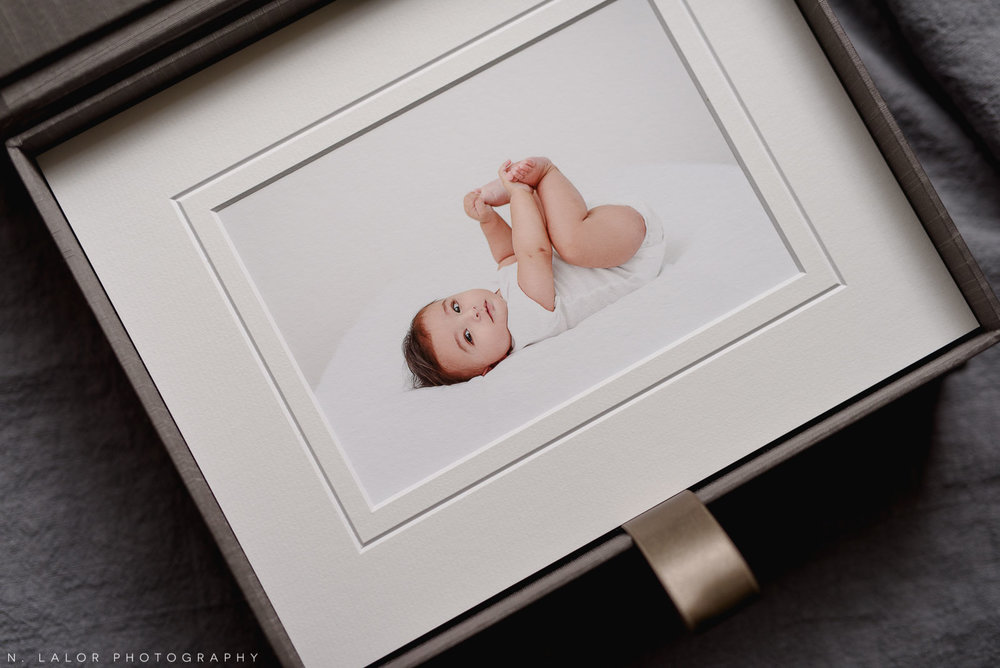 Image of a family heirloom box with museum quality prints. Portrait by N. Lalor Photography, Studio located in Greenwich Connecticut.