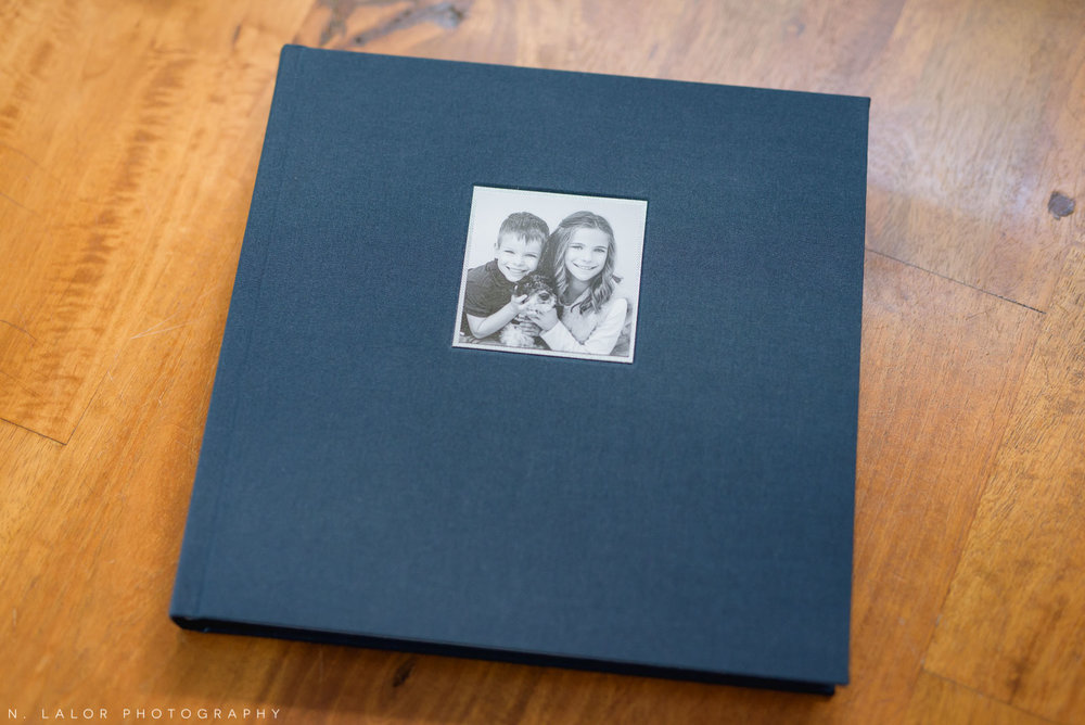 Image of a family heirloom Album with a blue linen cover material. Images by N. Lalor Photography, Greenwich Connecticut.