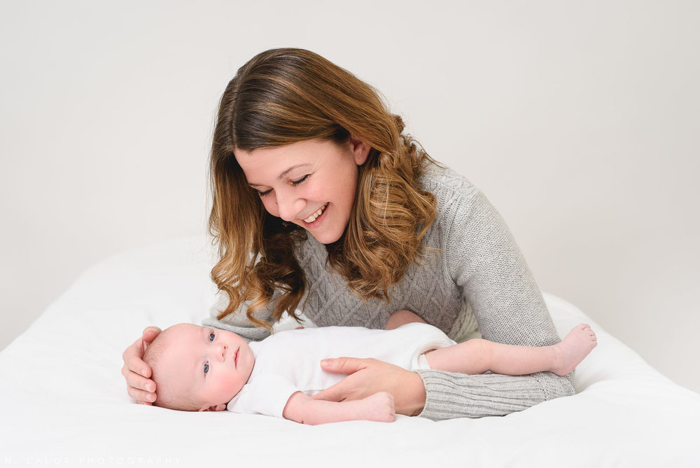 Image of a new Mom with her baby boy in a casual Studio setting. Studio portrait by N. Lalor Photography in Greenwich, Connecticut.