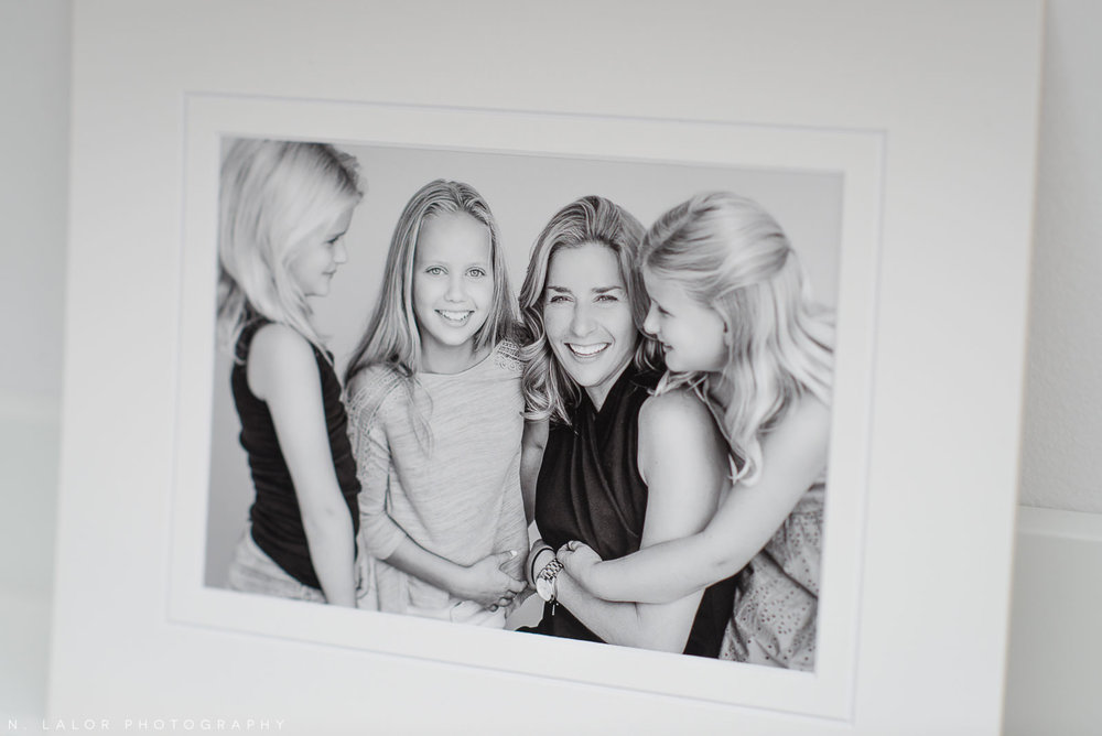 Image of a mom with her daughters, laughing. Studio family portrait by N. Lalor Photography in Greenwich, Connecticut.