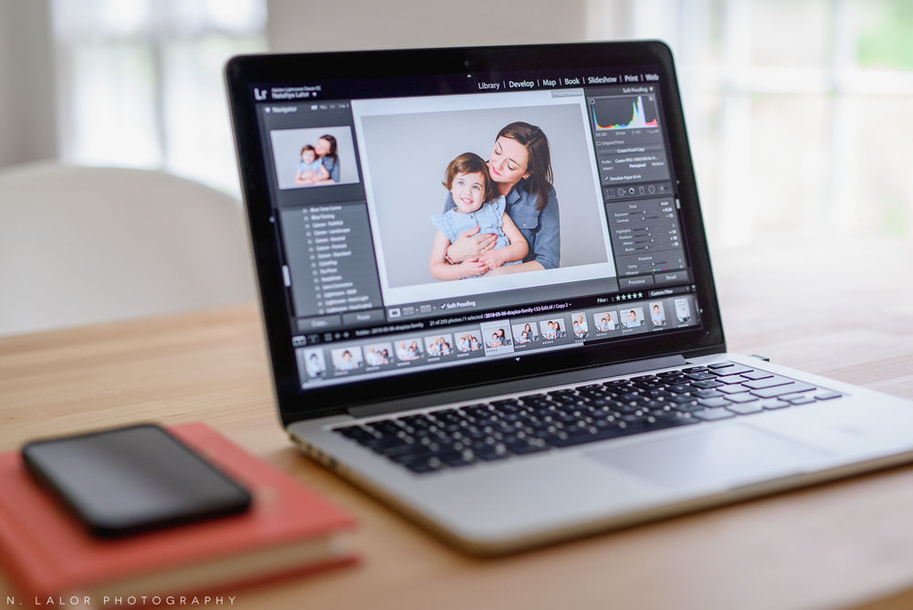 Image of a laptop screen showing photographs in Lightroom. Portrait by N. Lalor Photography in Greenwich, Connecticut.