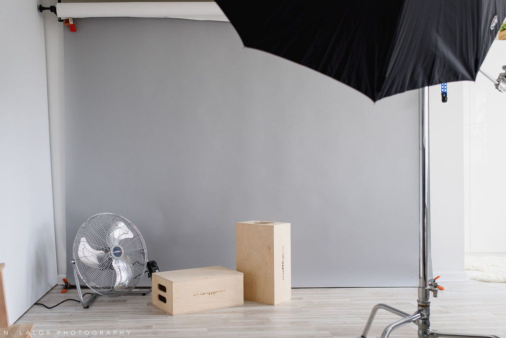 Studio interior showing seamless paper background, posing boxes, and fan. N. Lalor Photography in Greenwich, Connecticut.