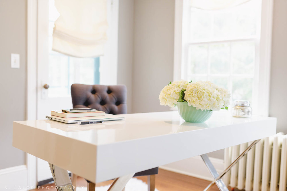 Image of a home office desk with flowers and lots of light. Lifestyle personal branding photo by N. Lalor Photography. Serving Fairfield County, Connecticut.