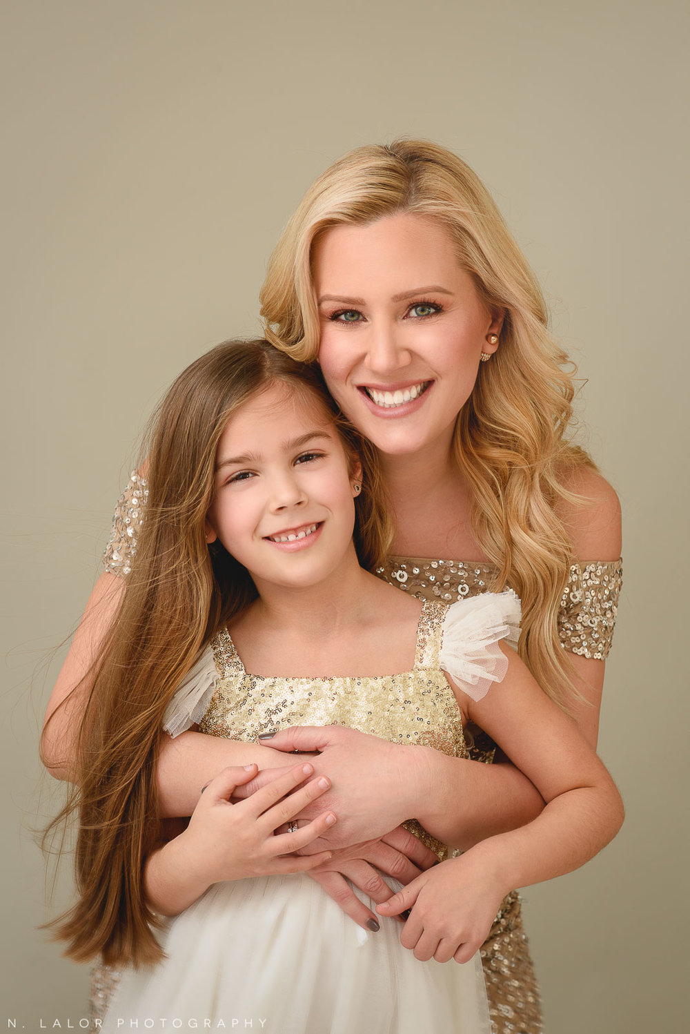 Image of a Mother and daughter hugging. Studio family portrait by N. Lalor Photography in Greenwich Connecticut.