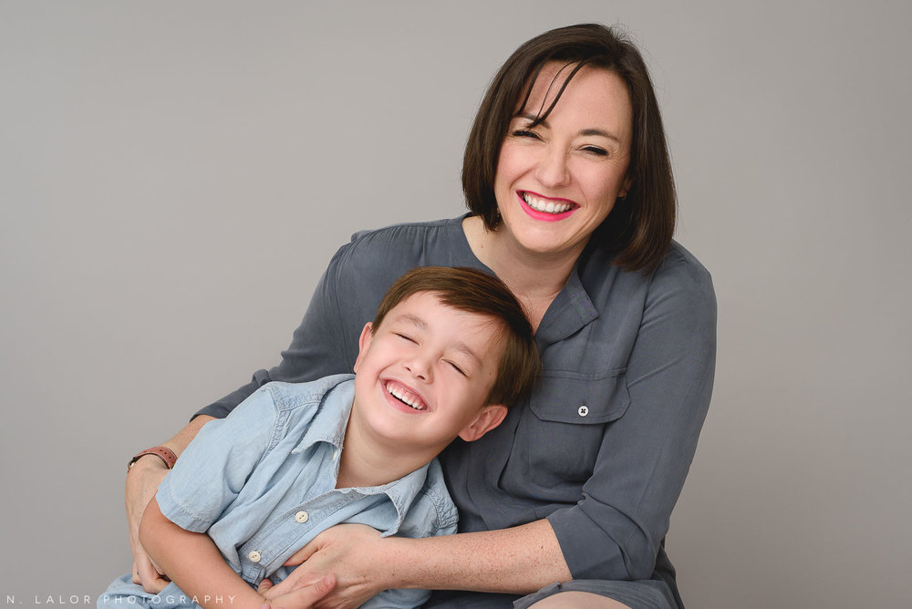 Image of a Mom laughing with her son. Studio family portrait by N. Lalor Photography in Greenwich Connecticut.