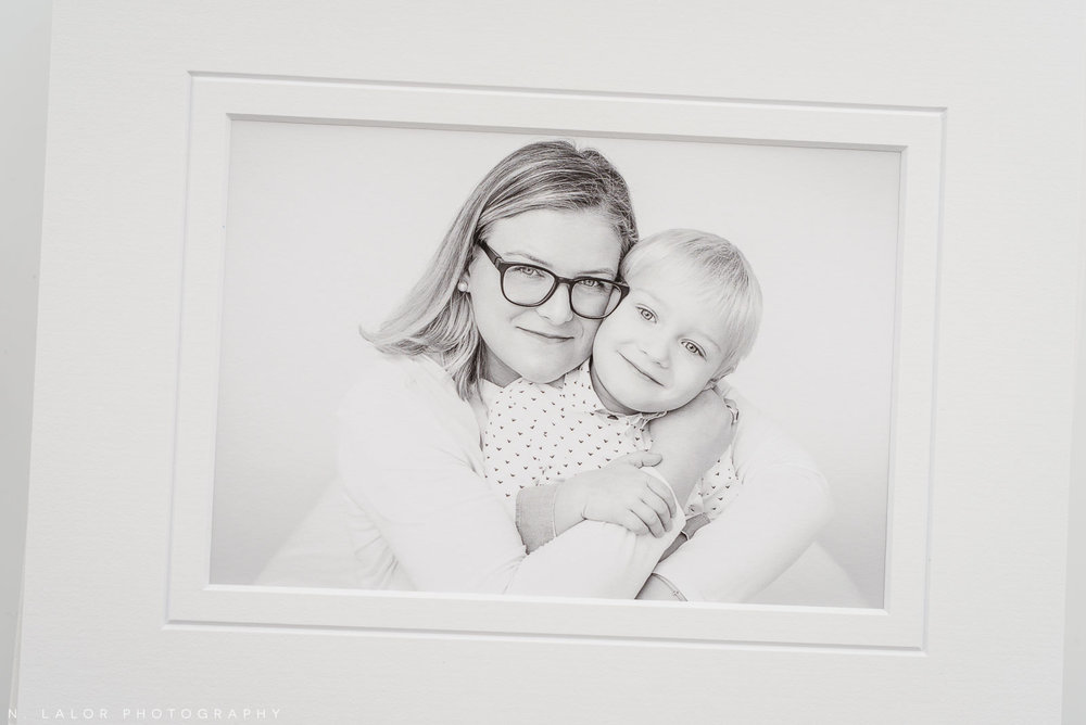 Image of a museum-quality print of a Mom hugging her son. Studio portrait by N. Lalor Photography in Greenwich, Connecticut.