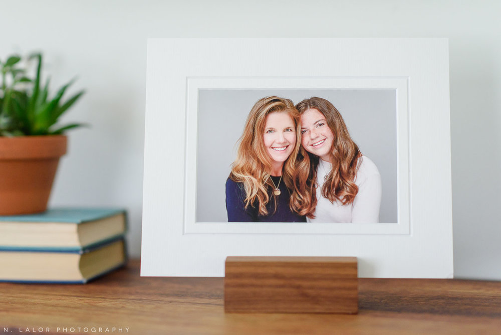 Image of a matted FineArt print of a Mom and her daughter, displayed on a tabletop using a photo stand. Studio portrait by N. Lalor Photography in Greenwich, Connecticut.