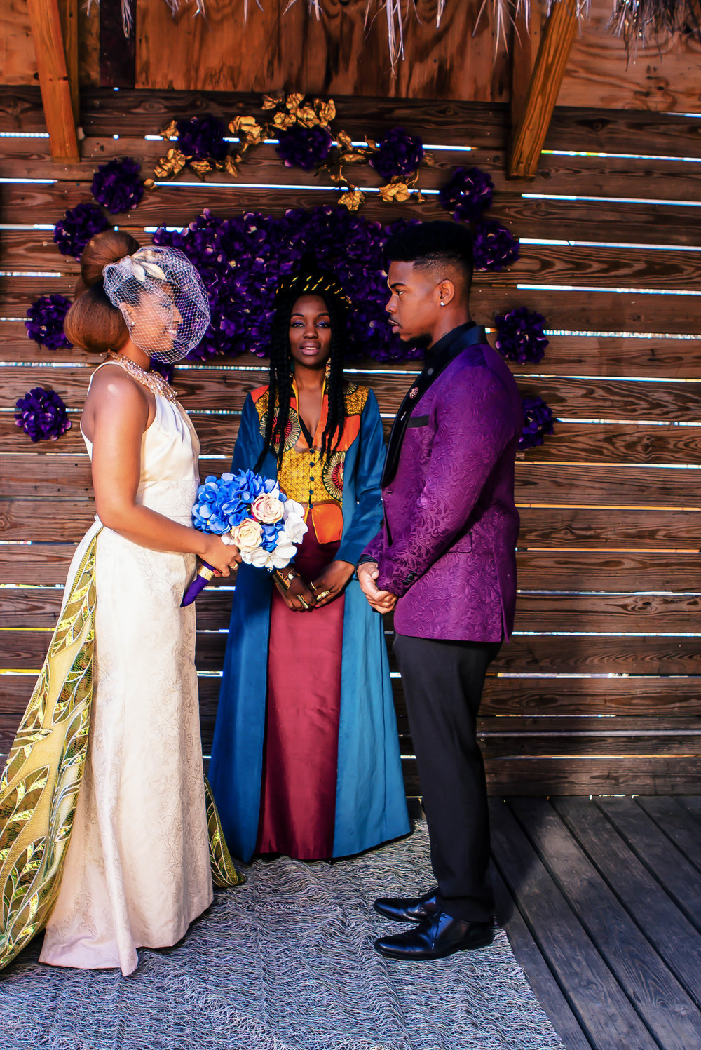 Luxe LeBlanc_Wakandan Wedding_Bride and Groom plus Officiant.jpg