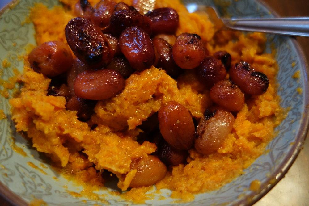 Mashed sweet potato with roasted grapes.