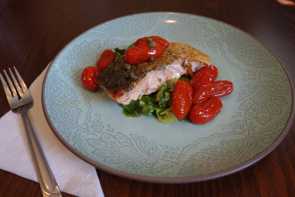 My own version of crispy skinned salmon with tomatoes & capers, inspired by my lunch the other day! Came out just as good!