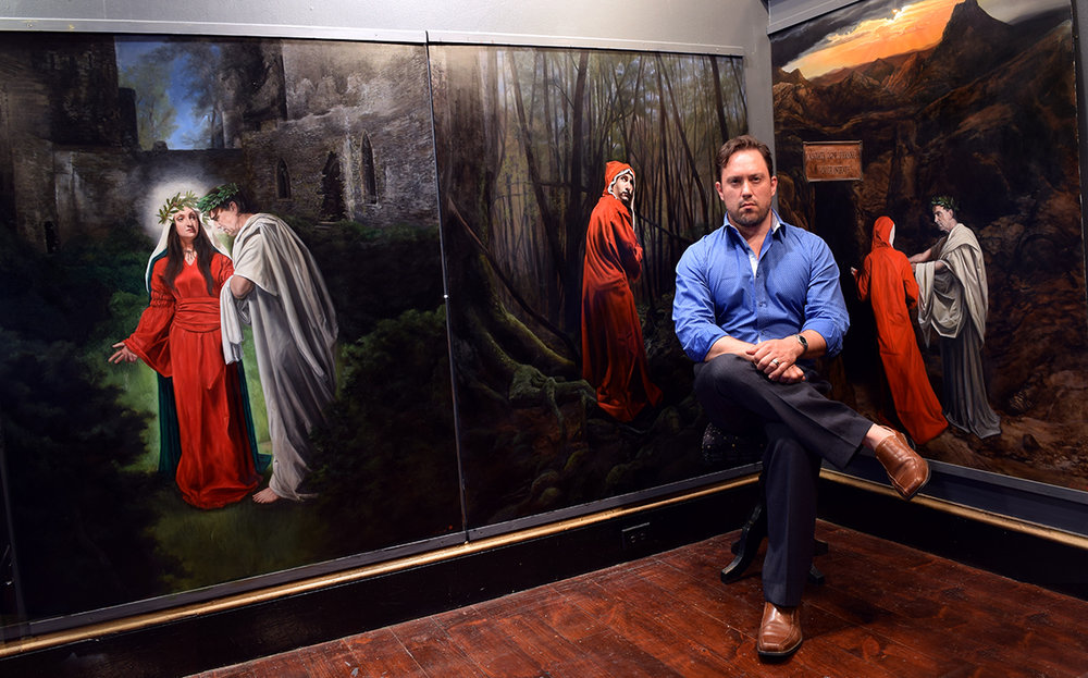 Eric sitting with the first three completed panels in his Dante's Inferno Series, June 2017