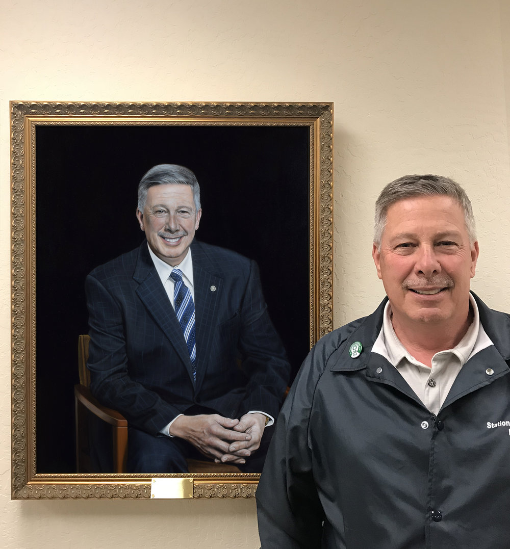 A picture of my client with his official portrait - July 2018