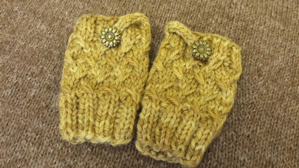 This tiny pair of fingerless mittens is called Farro (cuffs) by Carina Spencer. It features a slip stitch pattern and a moveable thumb divider and has sizes to accommodate children to adults....a quick and fun project with an easy skill level rating.  I hope that your day is full of simple pleasures and that you will take delight in each one that comes your way!