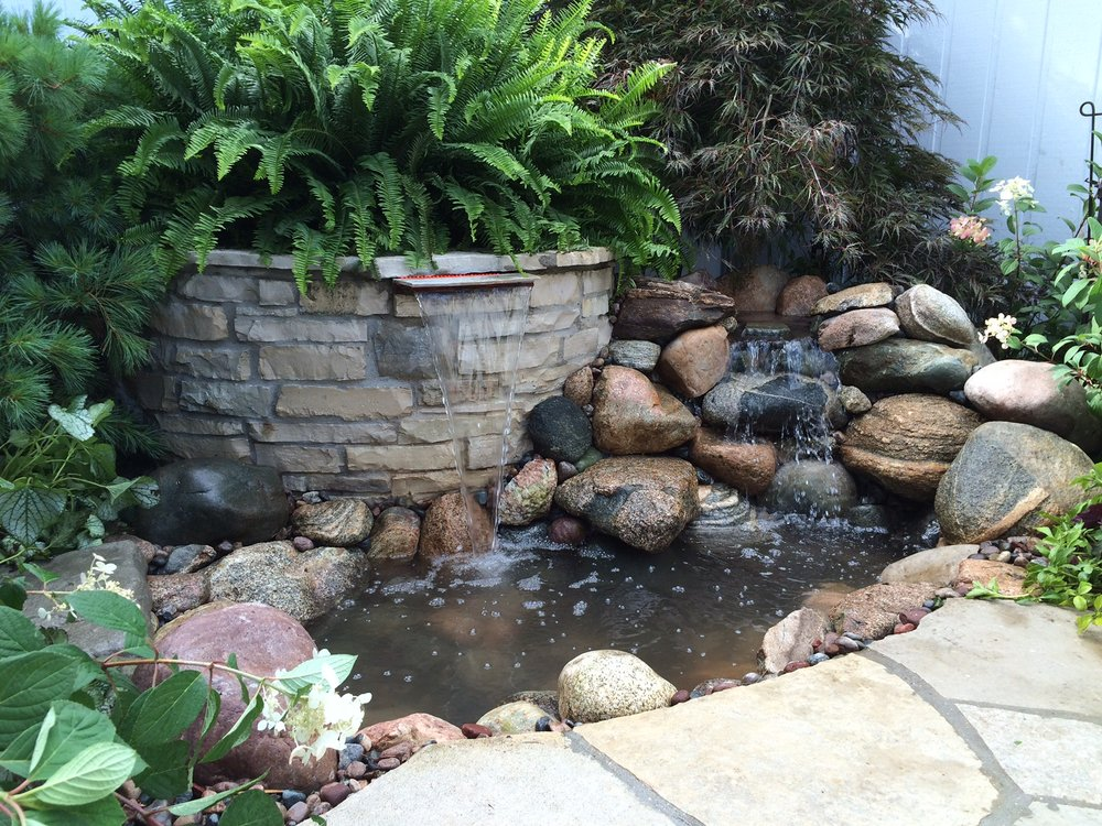 After our crew repaired and enhanced this fountain the client had a brand new entryway!