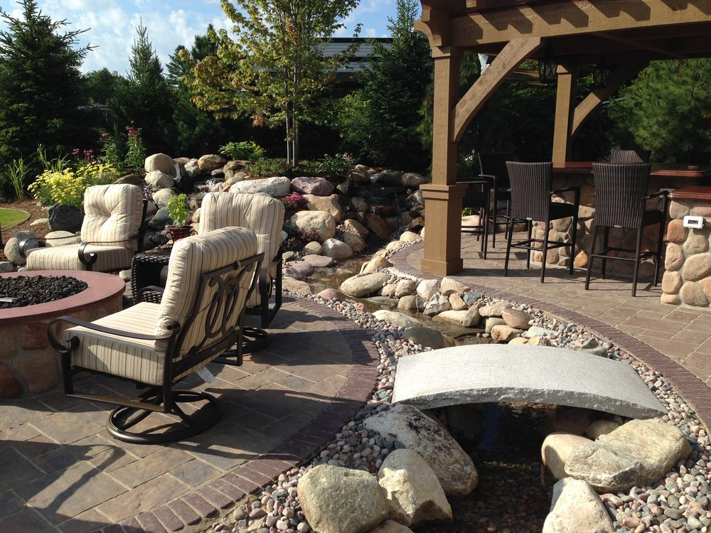 Your Michigan Outdoor Kitchen isn't complete without the ambiance of a Waterpaw Built Pond or Pondless System.