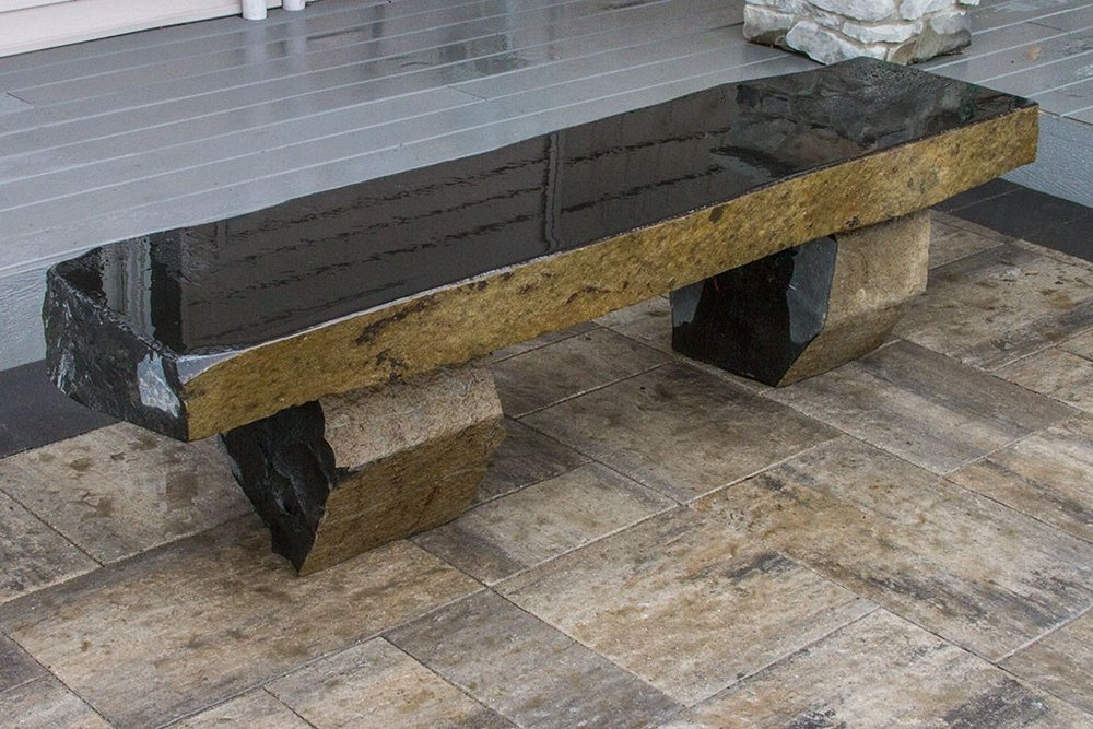For a more formal and modern feel a basalt bench can be the perfect addition.