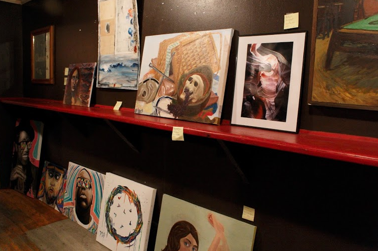 Local artist showcase art at a Dizzy Arts event