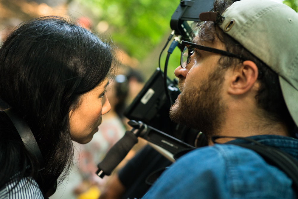 Writer/director Millicent Cho and cinematographer Shlomo Godder exchange words between takes
