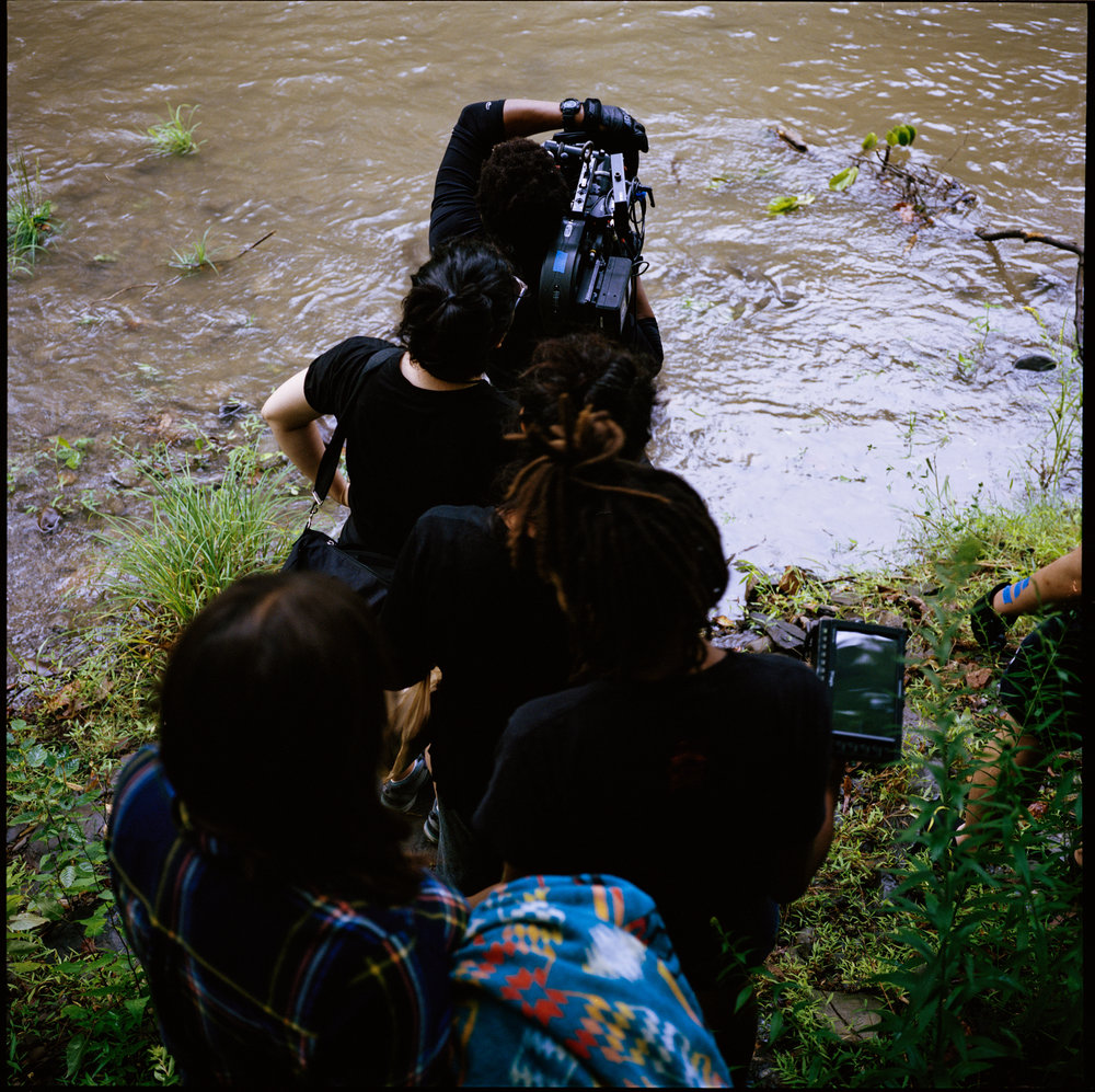 "front to back: cinematographer Jomo Fray, 1st AC Kristin Kouke, gaffer Zamarin Wahdat, writer/director Raven Jackson, and producer Maria Altamirano go into a take on the set of ""Nettles""  6x6 Kodak Portra (Medium Format)"
