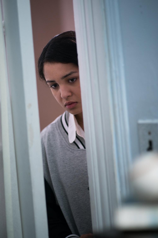 Naya (Crystal de la Cruz) peers into Abdul's room