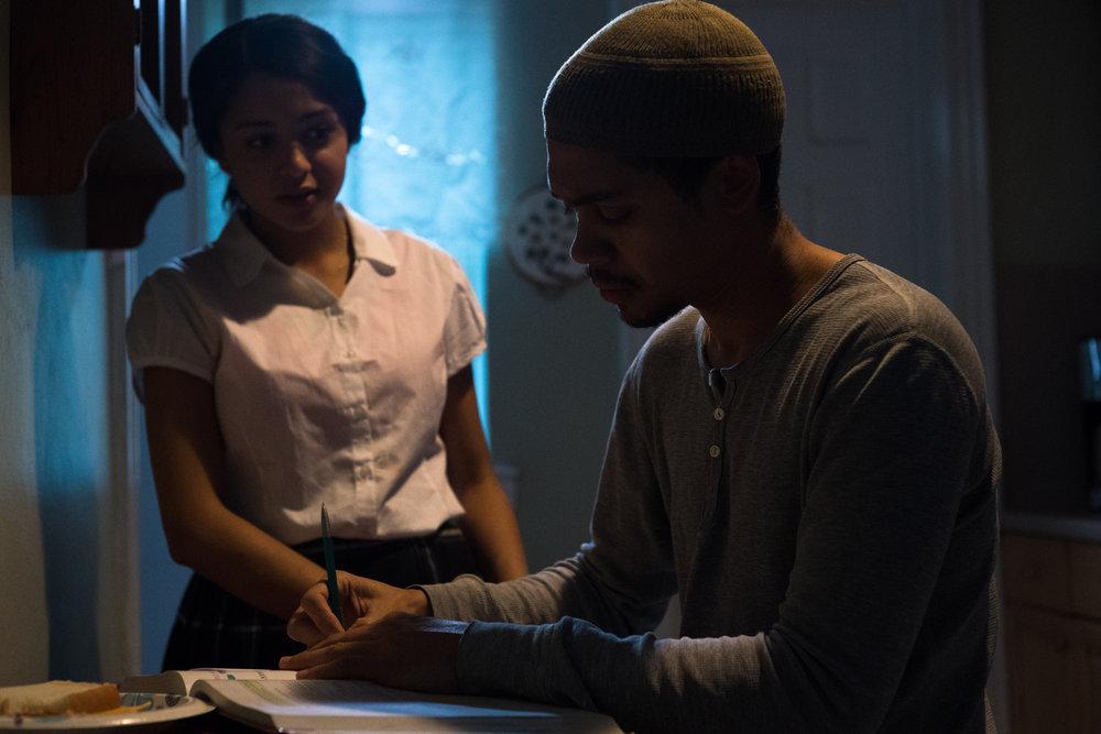 Naya (Crystal de la Cruz) helps Abdul (Reynaldo Piniella) with his math homework