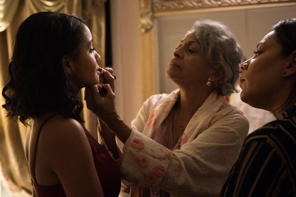 Naya (Crystal de la Cruz) gets a makeover by Mami (Awilda Santana) and Pamela (Selenis Leyva)