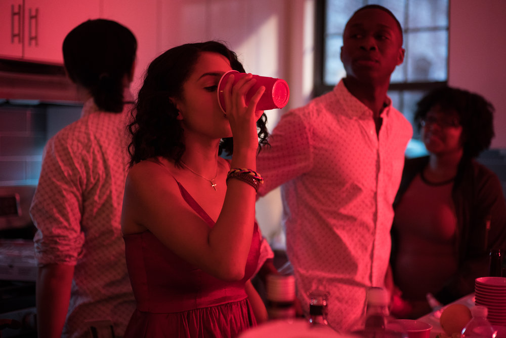 Naya (Crystal de la Cruz) gets her drink on