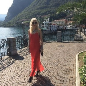"""I'm really influenced by my environment,"" notes Vee. Here the musician strolls Lake Como, Italy, in a Vince Camuto maxi dress."