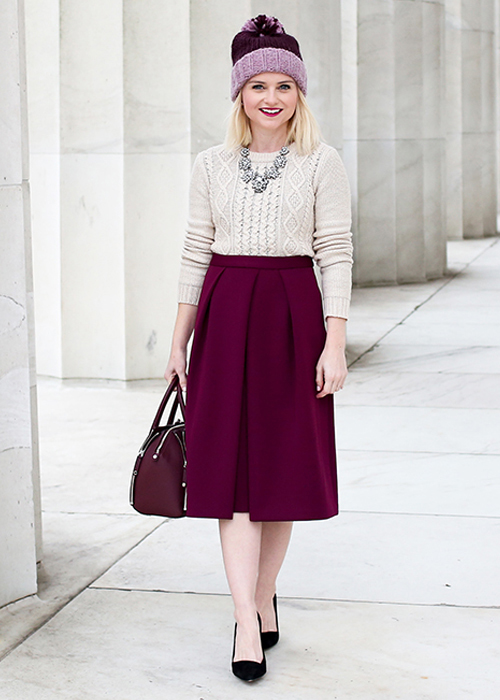 Cathy Anderson wears the Vince Camuto Scuba Pleated Midi Skirt.